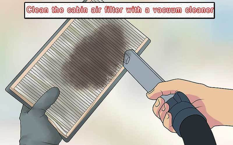 Clean the cabin air filter with a vacuum cleaner
